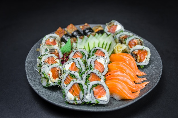 Sushi, traditional japanese cuisine. several delicious sushi on the decorated plate.