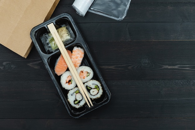 Sushi tray on a black