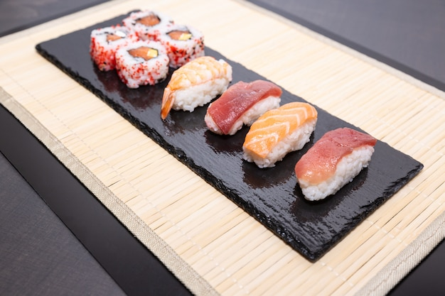 Sushi, a typical japanese food prepared with a base of rice and various raw fish.
