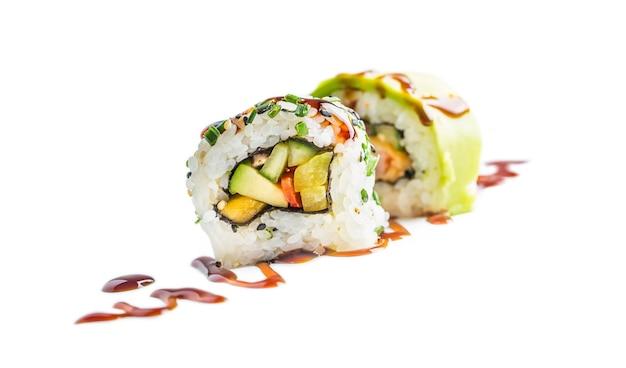 Sushi uramaki with soy sauce isolated on white background.