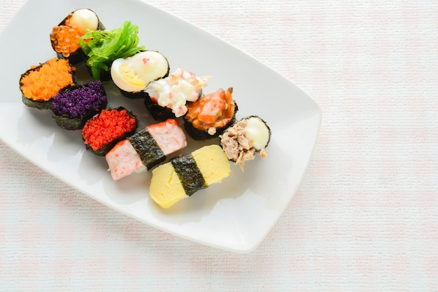 Sushi on white plate, tuna, salmon, sea bass, sweet egg, shrimp sushi, japanese food
