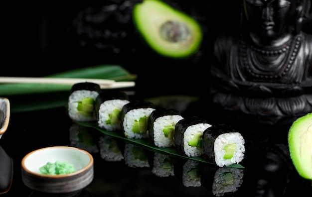 Sushi with avocado and rice and horseradish