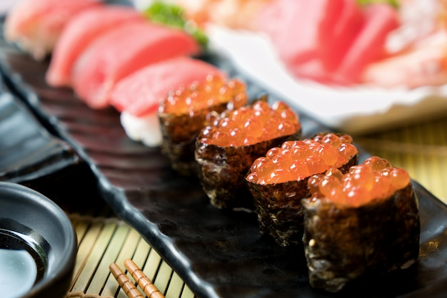 Sushi with chopsticks and soy sauce.