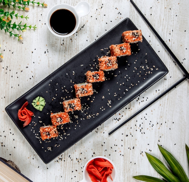 Sushi with red caviar and sesame seeds
