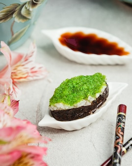 Sushi with rice and green caviar