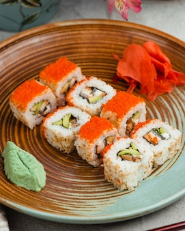 Sushi with rice red caviar ginger and wasabi