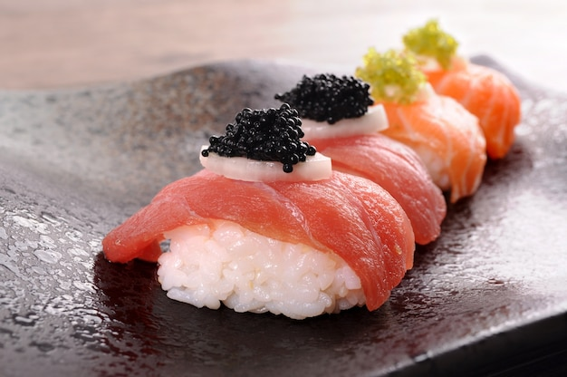 Sushi with rice, salmon and caviar
