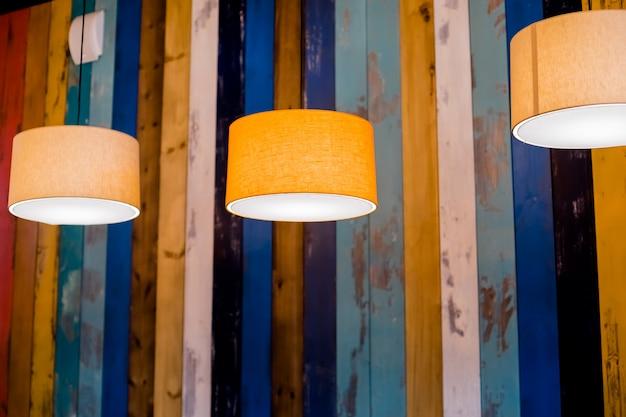 Suspended ceiling lamp. home, hotel, restaurant interior. orange lampshade. cozy place