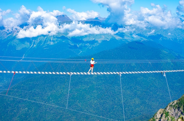 Suspended wooden bridge over the precipice. extreme vacation.
