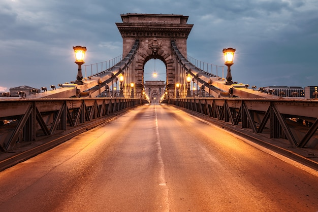Suspension bridge in budapest, hungary at night