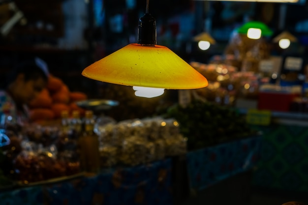 Suspension light or lamps hanging in the corridor in the market.