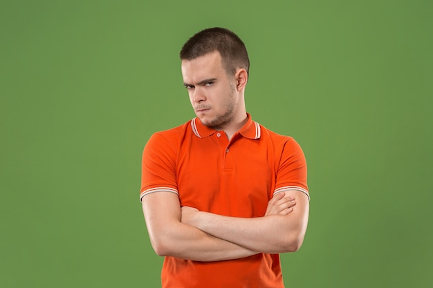 Suspiciont. doubtful pensive man with thoughtful expression making choice