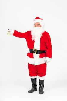 Suspicious santa claus standing and rigning bell