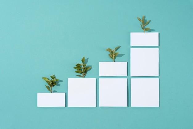 기하학적 형태에서 자라는 식물의 지속 가능성 개념 프리미엄 사진