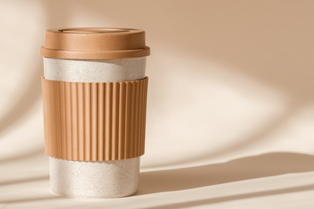 Sustainable bamboo eco friendly cup with silicone holder on natural shadow