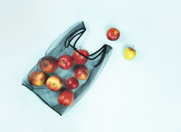 Sustainable eco packaging concept: shopping for groceries with a multi-use bag to reduce ecological footprint