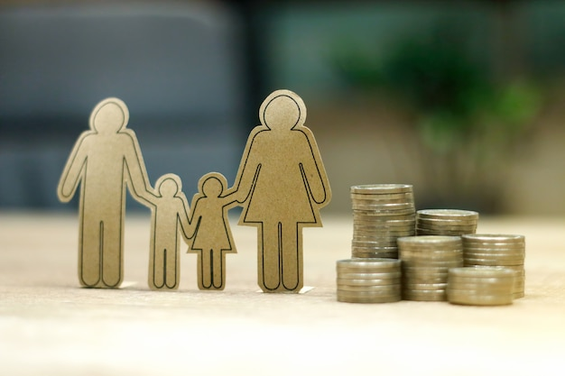 Sustainable financial goal for family life concept. parent & child with rows of rising coins, depicts savings or growth for new family