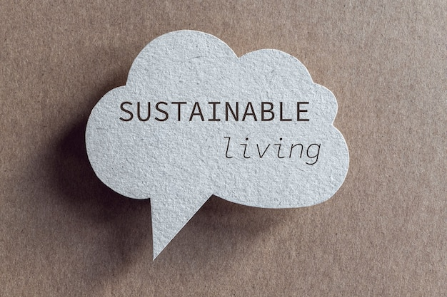 Sustainable living phrase on recycled cardboard speech bubble