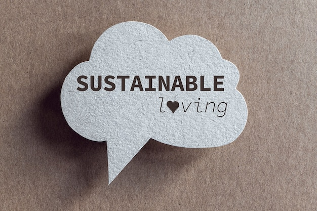Sustainable loving written on recycled cardboard speech bubble