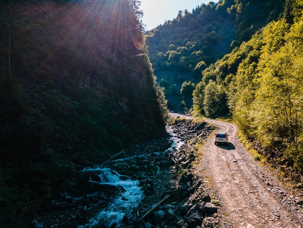 Suv car at off road. canyon in carpathian mountains. copy space