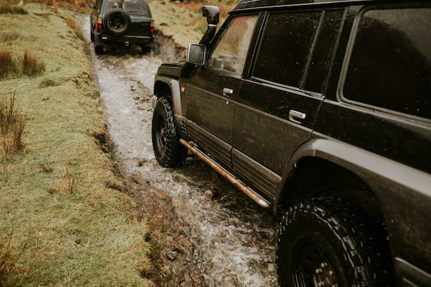 Suv cars off-roading in nature