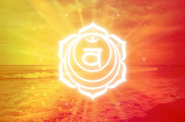 オレンジ色の背景にsvadisthanaチャクラのシンボル。仙骨チャクラとも呼ばれる第二のチャクラ