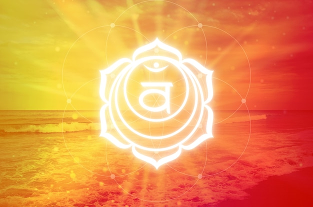 Svadisthana chakra symbol on orange background. the second chakra, also called the sacral chakra