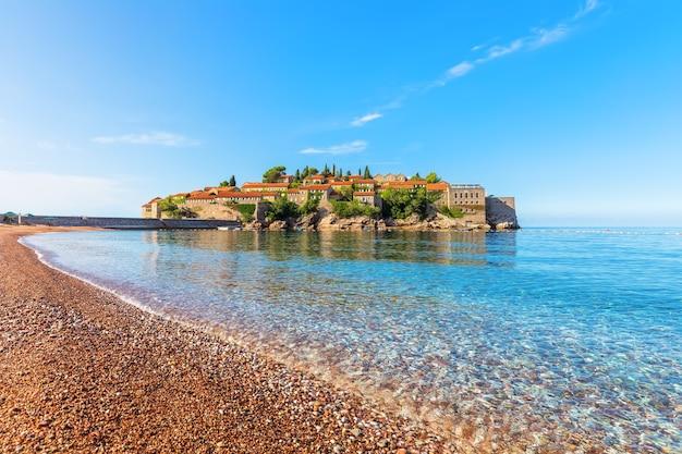 Sveti stefan islet near budva, view from the beach, montenegro.