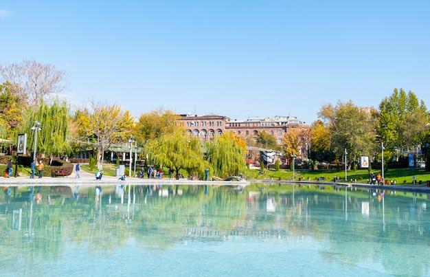 Swan lake in city park of yerevan on november in armenia