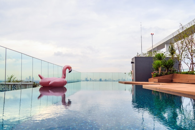 A swan rubble doll floating in the rooftop pool.