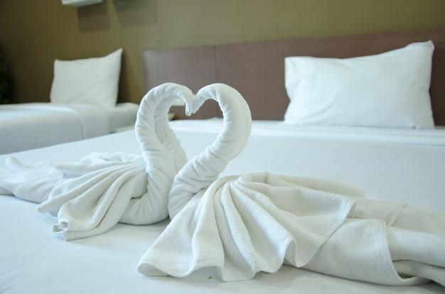 Swan towel on bed