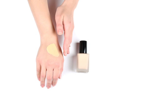 Swatch  of foundation on the hand isolated on white.