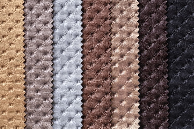 Swatch of leather textile with chesterfield pattern brown and gray colors, background.