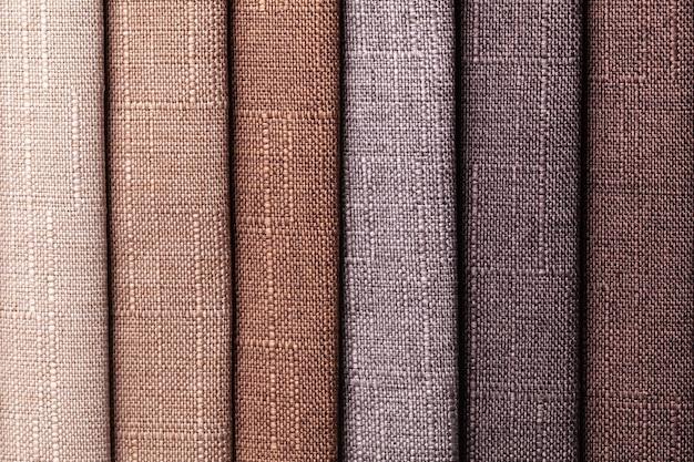 織物の茶色と灰色の色見本、背景。家具用インテリアファブリックのカタログ。