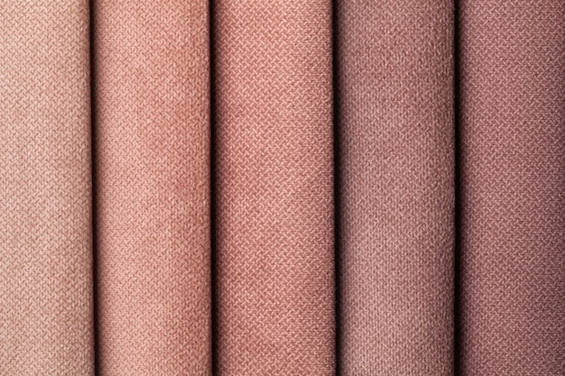 Swatch of velvet textile brown shade colors, background. catalog of fabric for furniture, closeup.