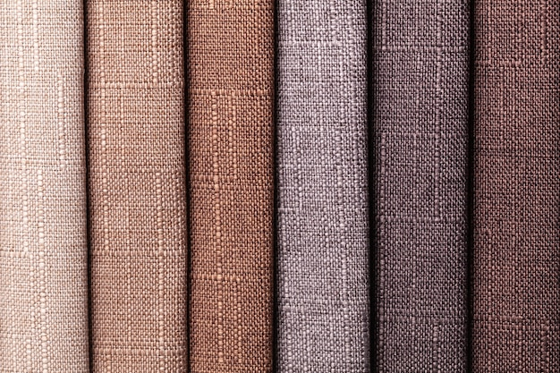 Swatch of woven textile brown and gray colors, background. catalog  of interior fabric for furniture.