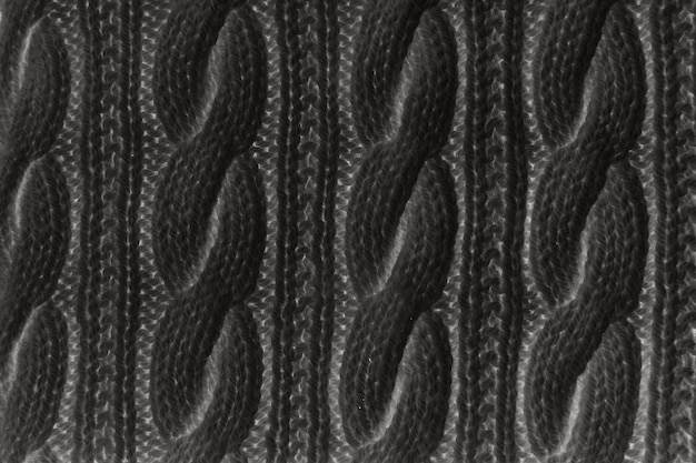 Sweater or scarf texture large knitting. knitted jersey background with a relief pattern.