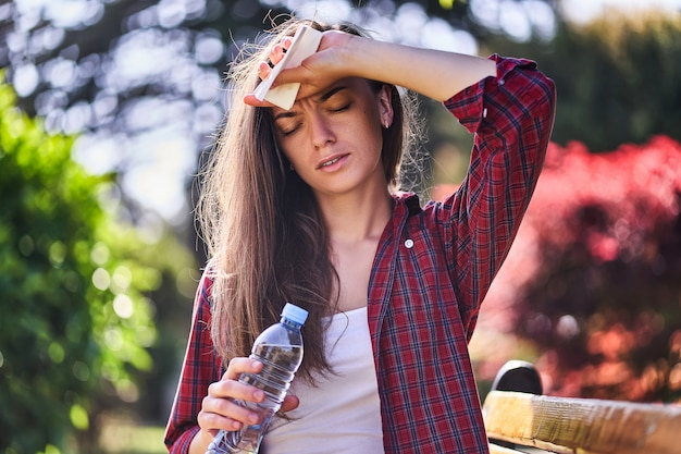 Sweating woman with water bottle