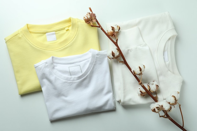 Кофты, футболка и хлопок на белом