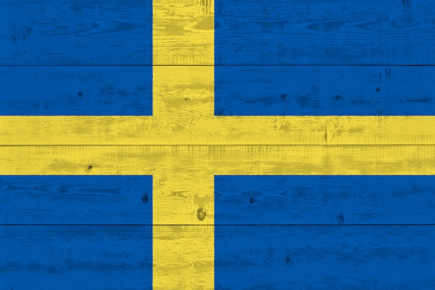 Sweden flag painted on old wood plank