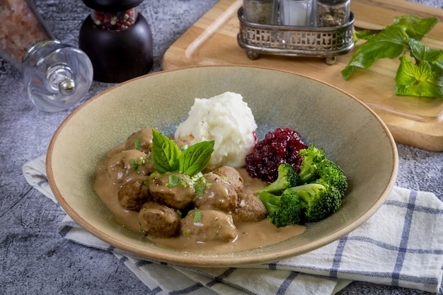 Swedish meatballs with creamy gravy, mashed potatoes and lingonberry sauce.