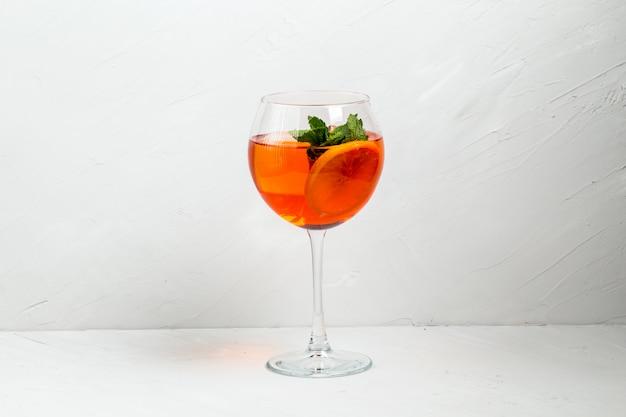 Sweet appetizing aperol spritz fruit cocktail