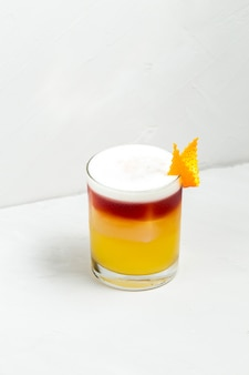 Sweet appetizing decorated cocktail in a glass