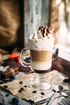 Sweet appetizing mocaccino coffee in a glass