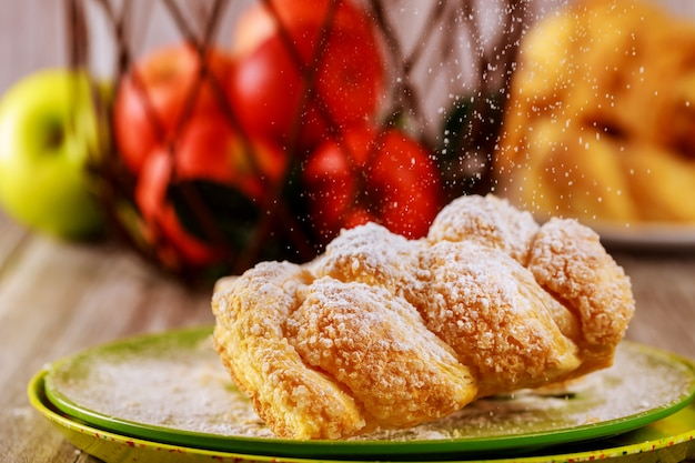 Sweet apple and cream cheese strudel sprinkle with powdered sugar.