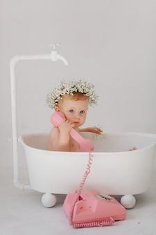 Sweet baby girl in bathroom
