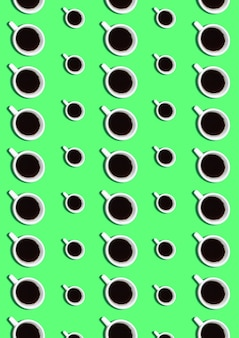 Sweet background. seamless pattern with coffee cups on green