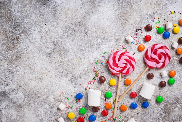 Sweet background with lollipop, candy and  marshmallow