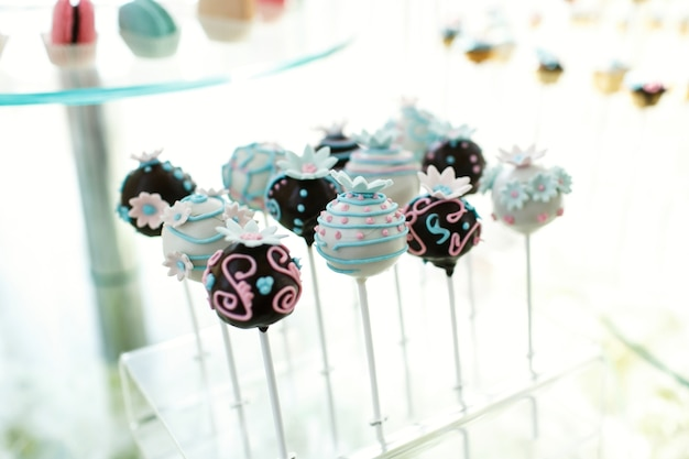 Sweet balls covered with white and black chocolate