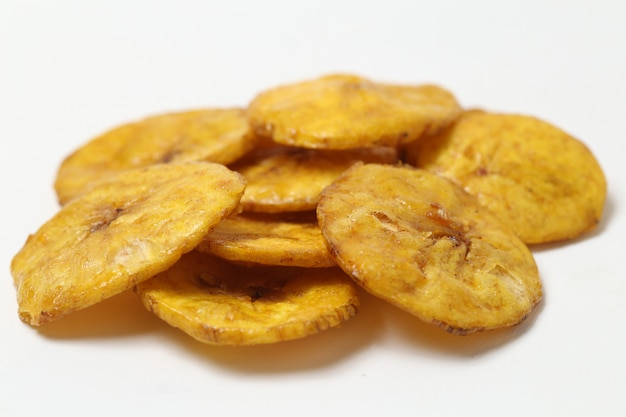 Sweet banana chips isolated on white space